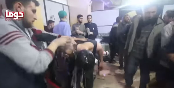 People being hosed down inside a hospital in Douma, Syria. These images were widely circulated in the U.S. media in the run up to U.S. airstrikes against Assad. / Image: CGA screenshot from news broadcasts.
