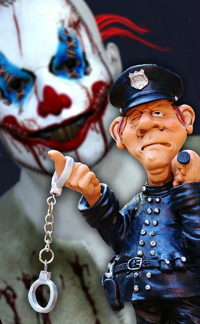 police officer with handcuffs stands as evil clown lurks in background