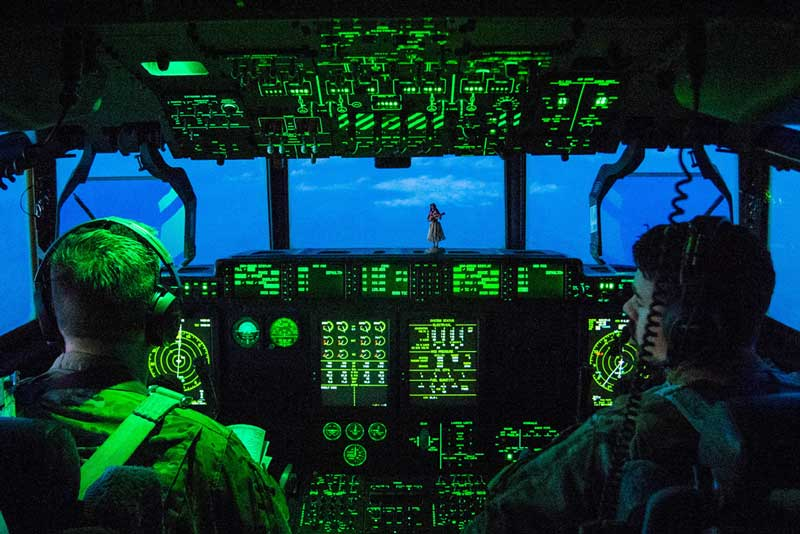 Air Force C-130 Hercules aircraft pilots prepare to land at Bagram Airfield, Afghanistan, March 22, 2018. DoD photo by Navy Petty Officer 1st Class Dominique A. Pineiro