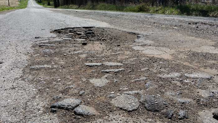 Crumbling roads and potholes