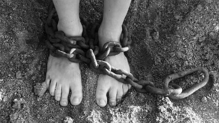 white child in chains