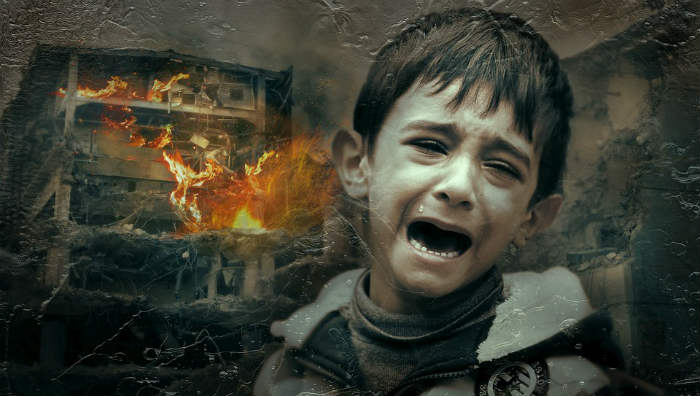 war scene of child crying in front of a burning building